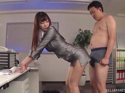 Asian secretary Mitani Akari gives a blowjob and gets fucked in doggy