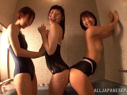 Riku Minato enjoys a lesbian put on on her wet pussy in the bath