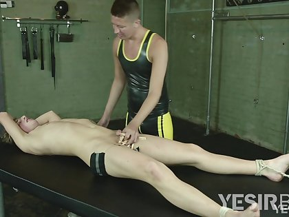 Naked twink endures full anal domination BDSM