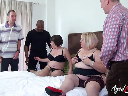 Chubby whore Trisha has invited chubby old bitch to work on high several cocks