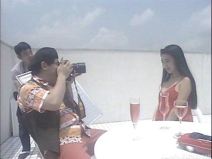 Naughty photographer gets his Hawkshaw pleasured by Hitomi Shiraishi