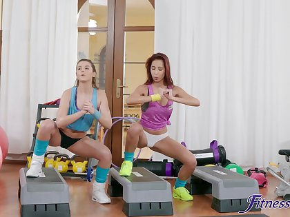 Horny babes Sybil Kailena and Paula Backward have sex in the gym